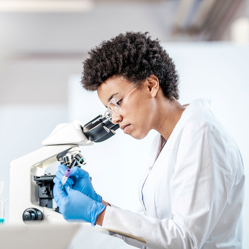 A photo of a women using a microscope