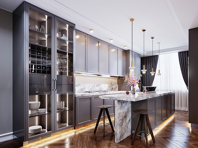 Fashionable modern kitchen with gray contemporary furniture, a kitchen island with a bar counter and two chairs, beige walls and parquet floor.