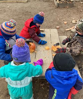 chopping frozen pumpkin