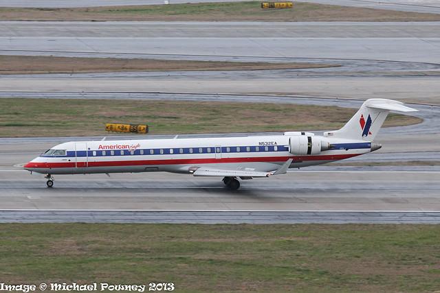 N532EA - 2010 build Bombardier CRJ700, arriving on a damp Runway 08L at Atlanta