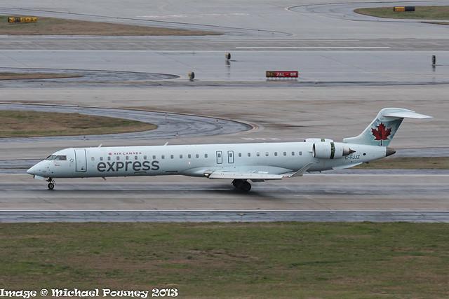 C-FJJZ - 2005 build Bombardier CRJ900, arriving on a damp Runway 08L at Atlanta