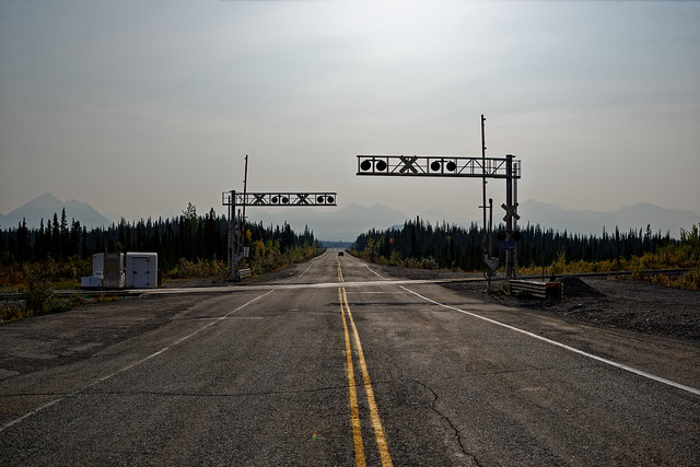 A View Looking Down the Parks Highway at a Railroad Crossing (Denali National Park & Preserve)