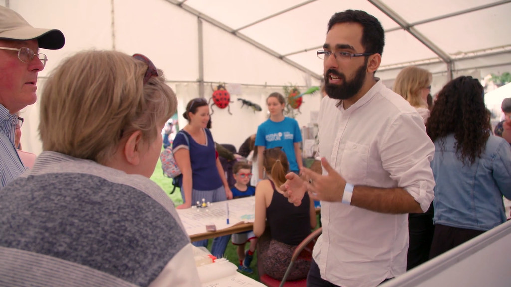 A researcher talking to talking to two visitors at the Festival of Nature
