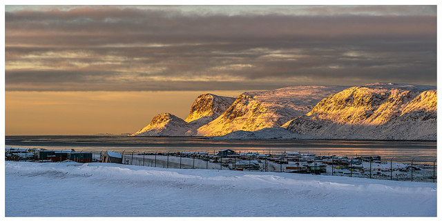 A low winter sunrise in Pangnirtung