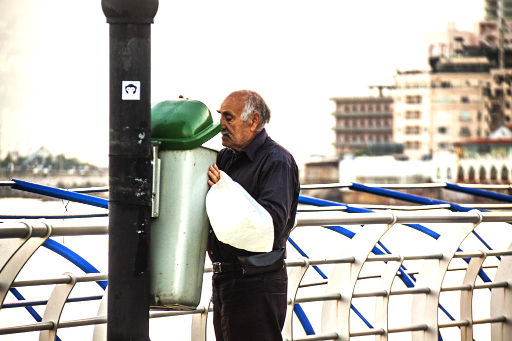 Old man scavenging from trash cans on Corniche El Manara on 12-18-20--Beirut