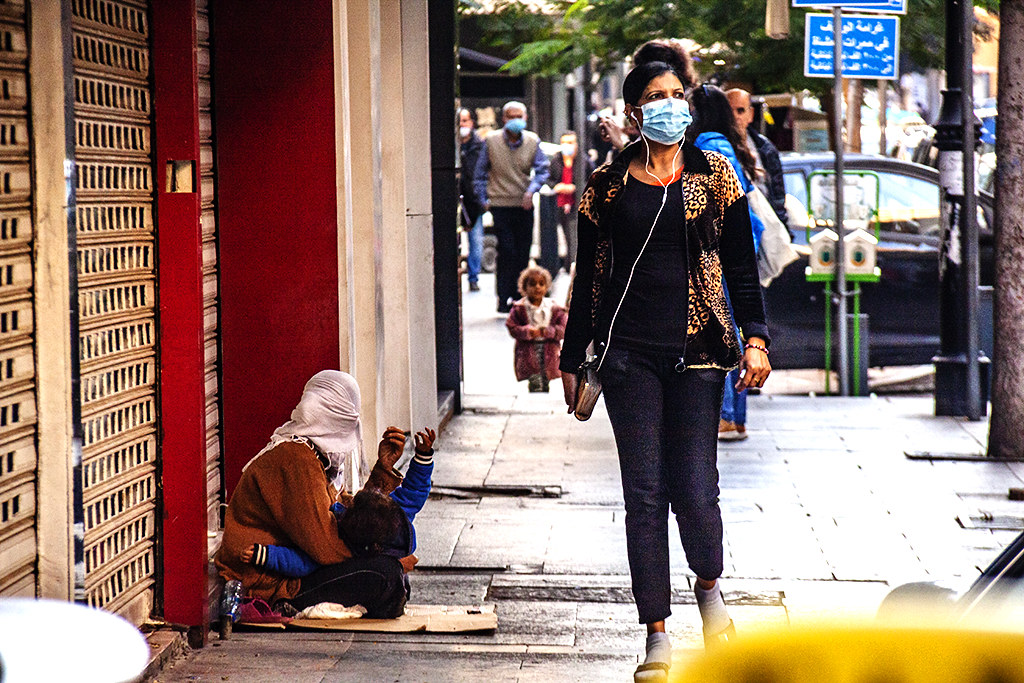 Mother and toddler begging on Hamra Street on 12-18-20--Beirut