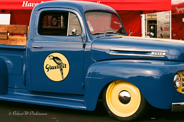 Classic Blue Ford Pickup with Yellow Wheels on Film