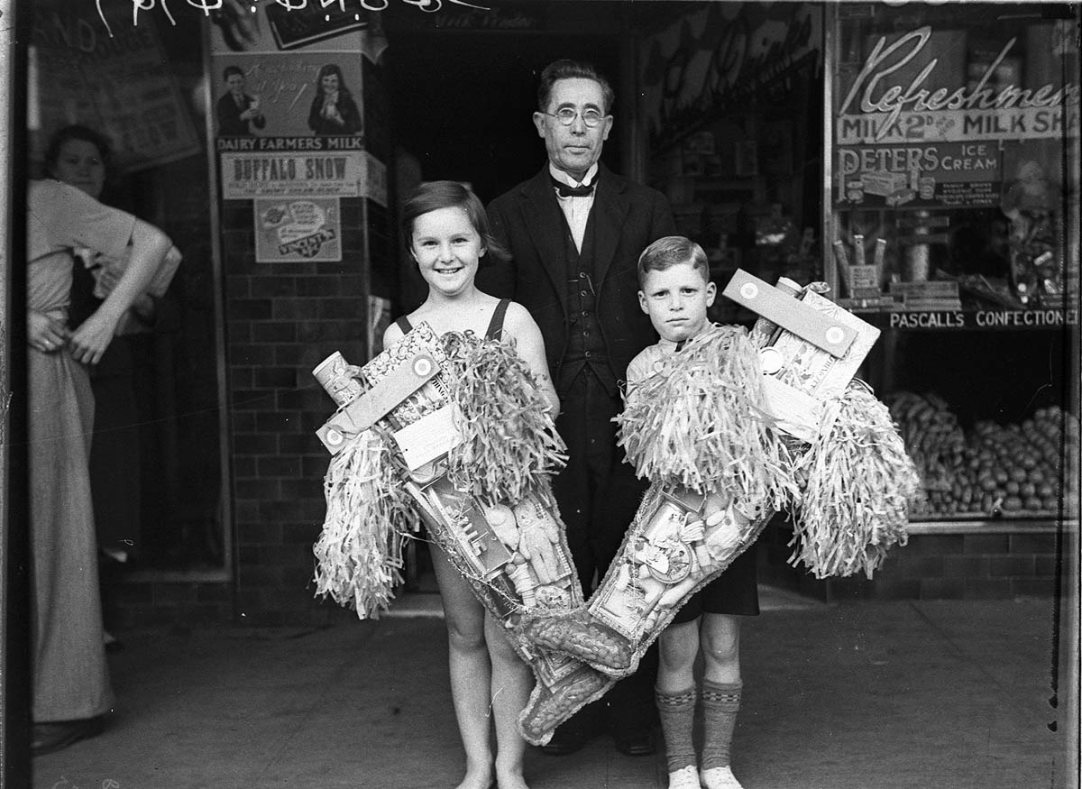 Doreen Beresford and Rennie Collins with their first and second prize Christmas stockings, Paddington, December 1934