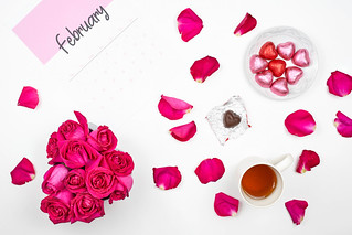 Beautiful rose flower petals, heart shape sweet chocolates and February calendar | by wuestenigel