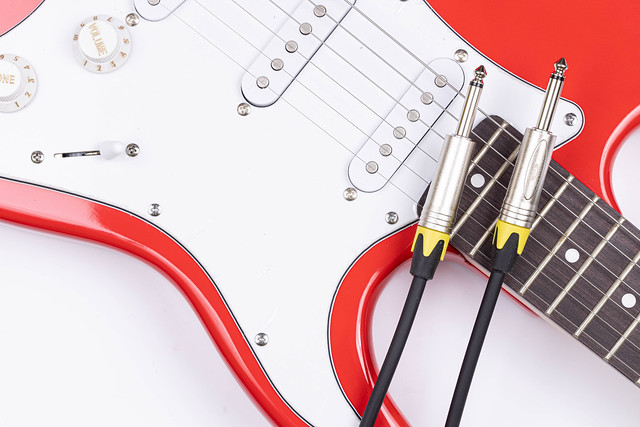 Brand New Electric Guitar with audio cables on it