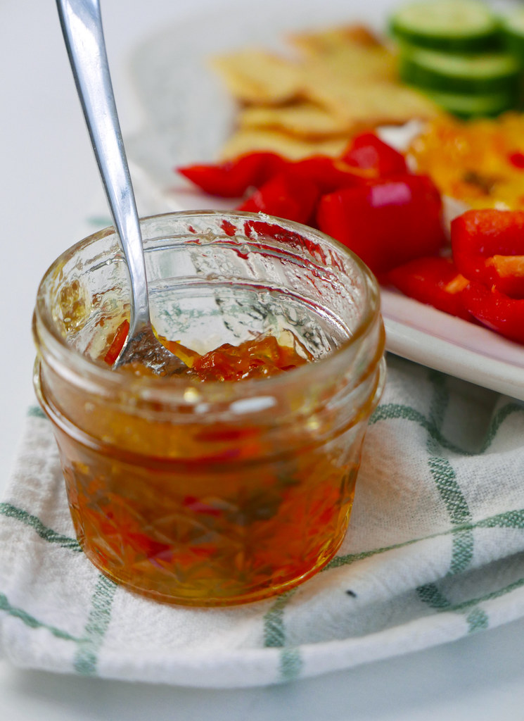 An opened jar of hot pepper jelly. our hot pepper jelly recipes makes 6 (8Oz) jars!