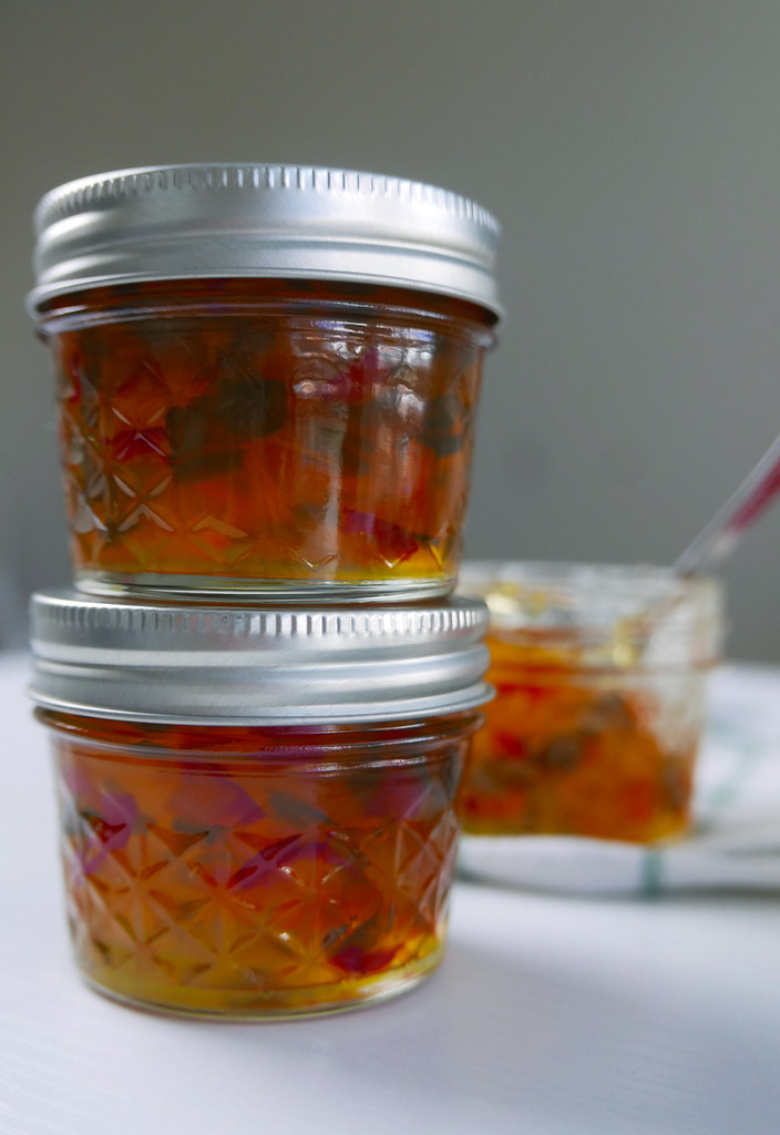 Let's learn how to jar our hot pepper jelly recipe: photographed are jars of hot pepper jelly stacked.