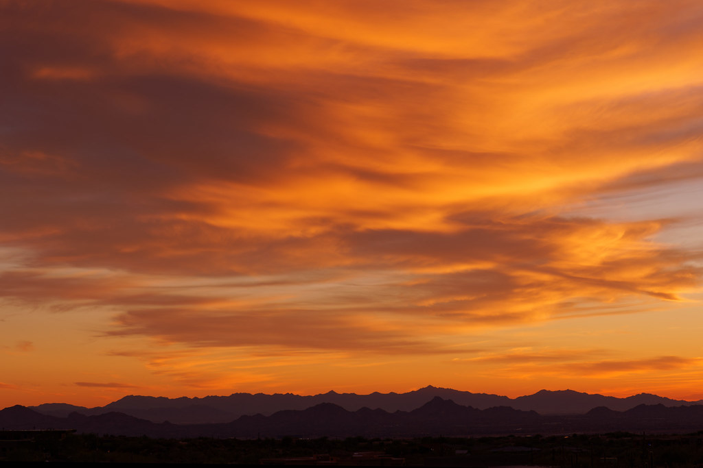 Orange clouds above the city and mountains at sunset at George Doc Cavalliere Park in Scottsdale, Arizona on December 13, 2020. Original: _CAM7580.arw