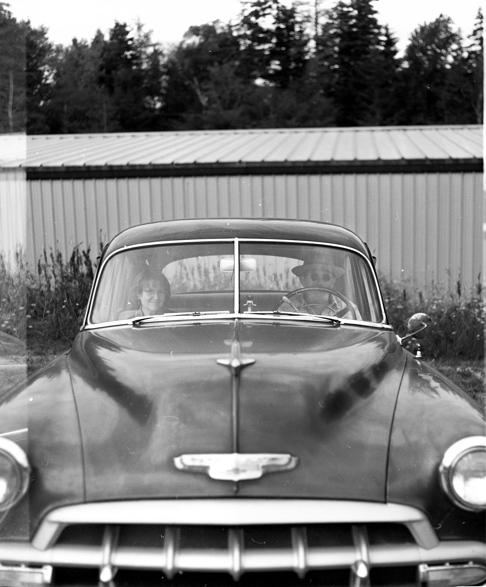 Vintage Couple in a Vintage Car