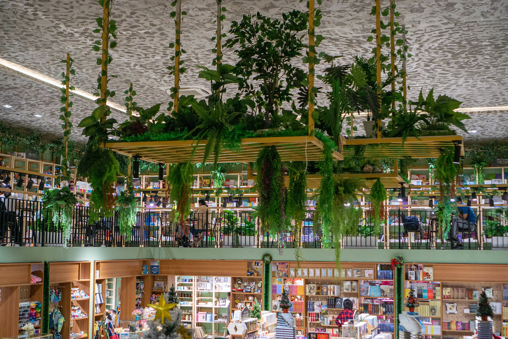 Hanging Wooden Board decorated with many Plants in a Multi Level Book Store in Ho Chi Minh City, Vietnam