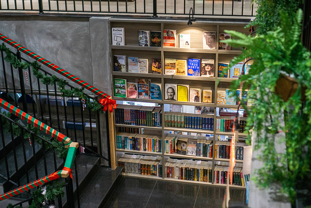 Book Display with different Softcover Books for Sale in a Staircase inside a Bookstore