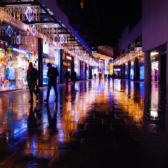 Lights and wet pavements.