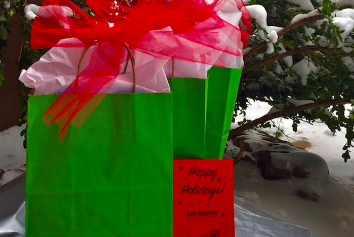 Holiday gift bags under a tree