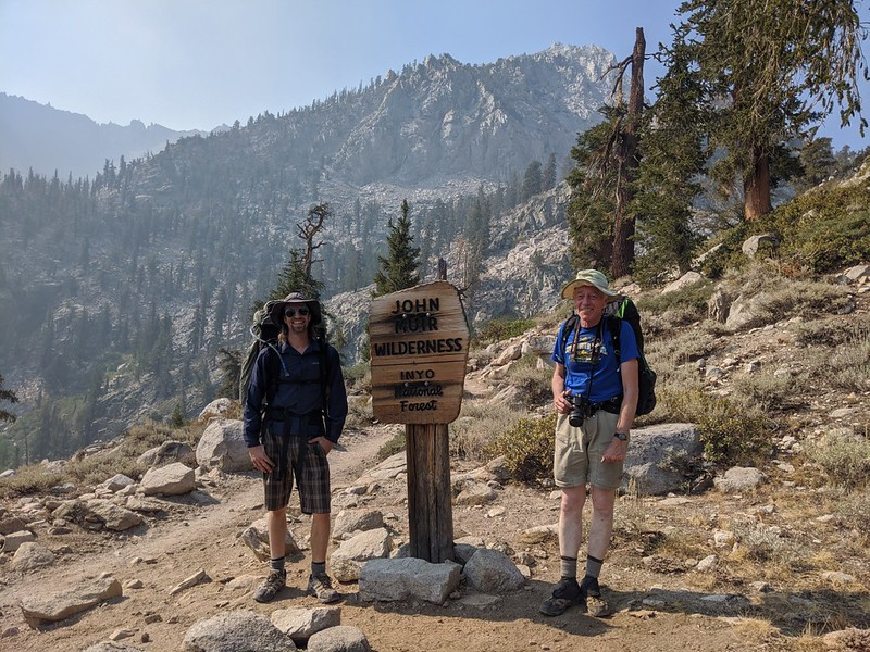 The two of us posing at the John Muir Wilderness sign on the Kearsarge Pass Trail above Onion Valley
