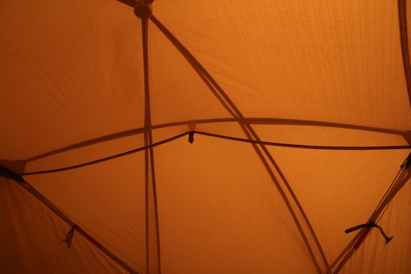 My tent is actually a light green color, but it looked orange under the smoky sky, and I needed a headlamp to read