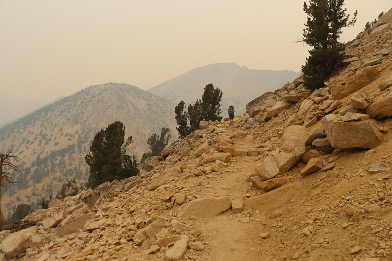 The Pacific Crest Trail turns north as it climbs toward Glen Pass - the rocks are all orange due to the smoky air