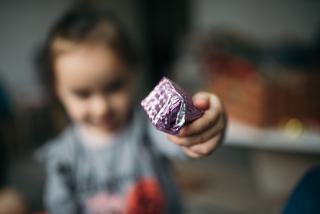 Little girl holding a small Christmas box.