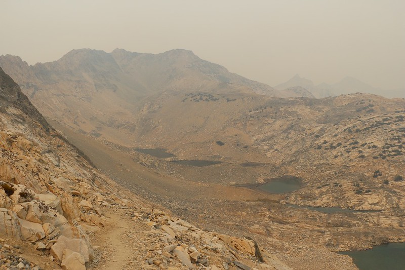 Looking west as we descend from Glen Pass on the PCT - the gray granite looks orange thanks to the smoke