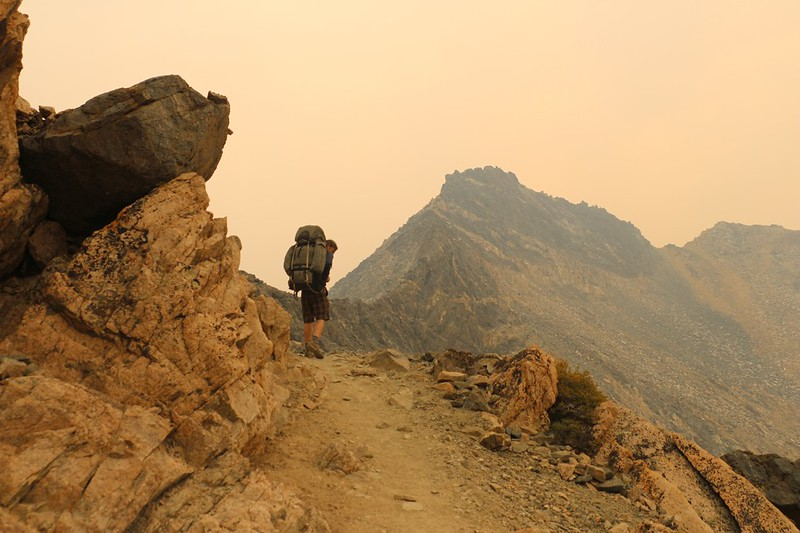 Everything looks orange in the smoky light as we summit Glen Pass on the Pacific Crest Trail