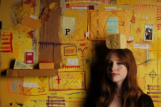 Portrait of a Young Woman with Three Cheeses on Yellow