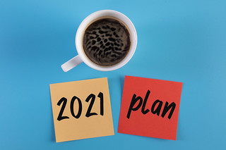 Coffee and sticky notes with 2021 Plan text on blue background | by wuestenigel