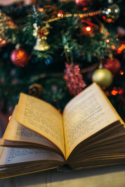 Old book with Christmas tree background.