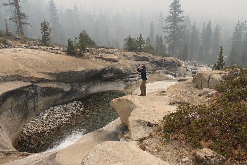 Standing up above the deep pool worn into the granite by Woods Creek along the Pacific Crest Trail