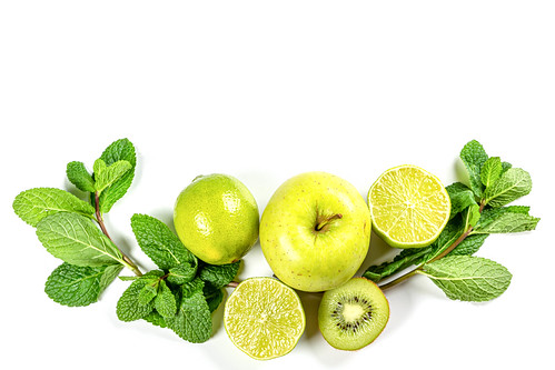 Green fruits and sprigs of mint on white, top view | by wuestenigel