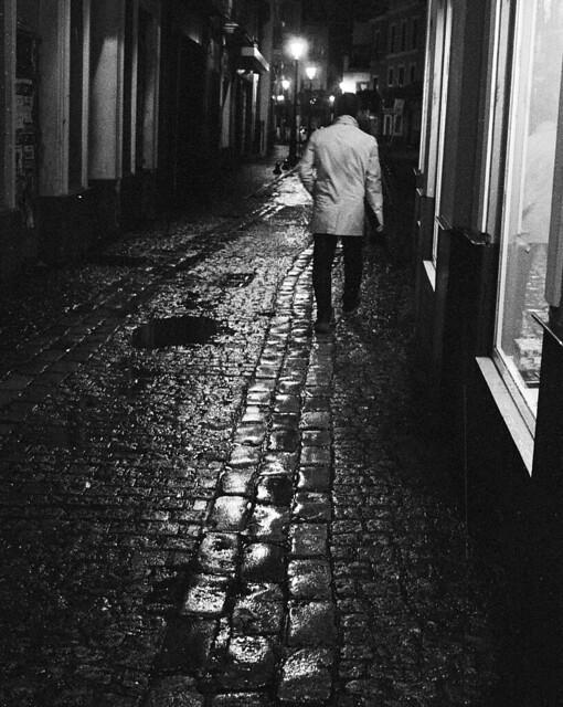 walking through the rainy night alone