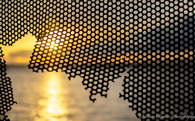 River Humber sunset through broken fence