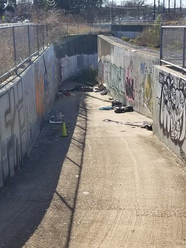 homeless encampment near dam