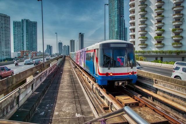 BTS Skytrain of the Light Green Line arriving at Saphan Taksin station in Bangkok, Thailand