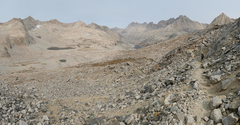 Wide angle panorama view of the basin below Mather Pass, looking down to the Palisade Lakes, from the PCT