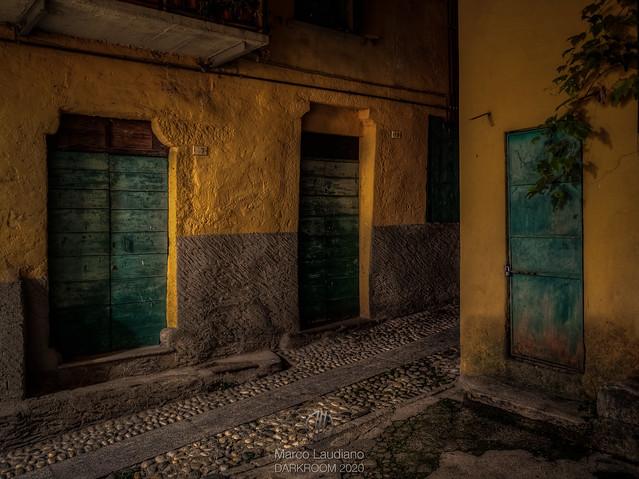 Three green doors in the dark