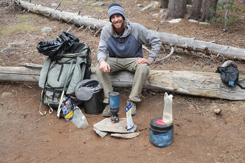 Cooking our freeze-dried Mountain House Dinner on a JetBoil stove next to Palisade Creek on the PCT-JMT