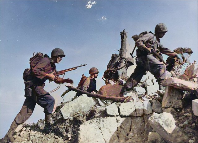 Equipped for any emergency, Marines hurdle a stone wall as they push across Okinawa_colorSAI_result