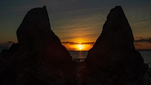 beach celticsea coppercoast kilfarrasy landscape outdoor rocks sun sunset water winter clouds coast coastal coastline ireland munster sea seascape silhouette sky stones waterford