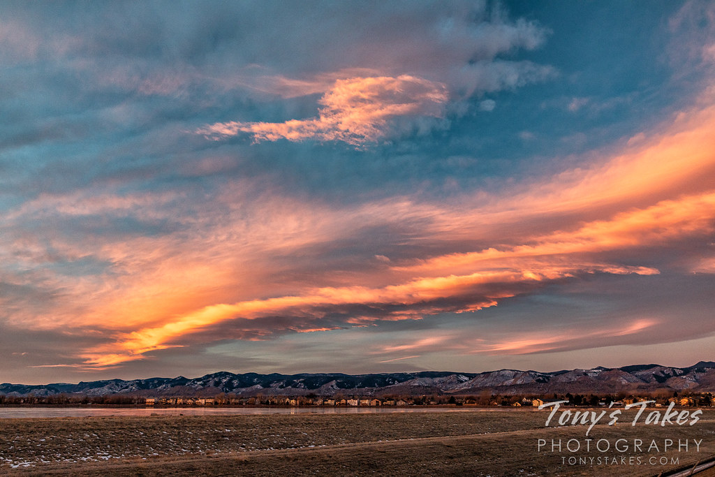 Sunrise lights up a wave cloud over the Colorado foothills. (© Tony's Takes)