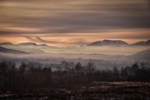cumbria fells cumbrianfells castlerigg castleriggfell mountains snow snowy mist misty dusk lowlight cloudy trees sunset latrigg cloughhead winter winter2020 december december2020