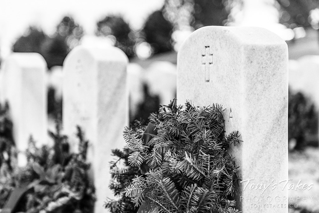 Wreaths decorate veterans' gravesites at Fort Logan National Cemetery in Colorado. (© Tony's Takes)