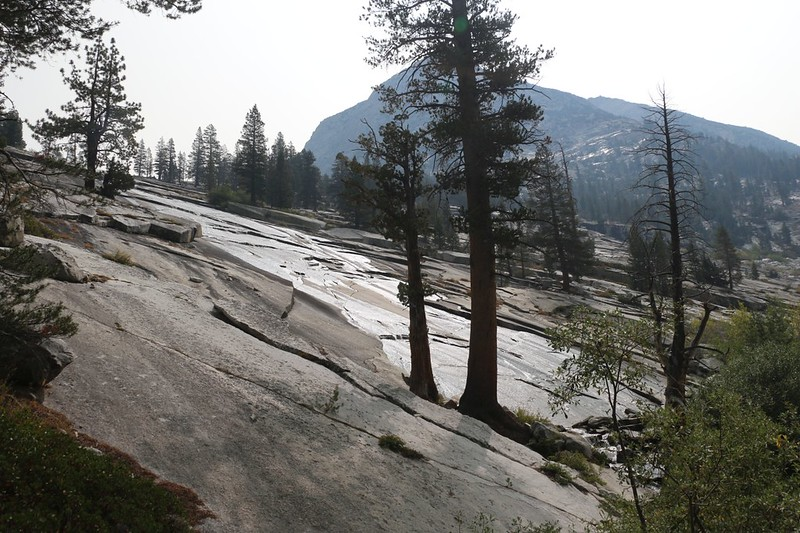 The Dusy Branch flows down over smooth glaciated granite into Le Conte Canyon, from the Bishop Pass Trail