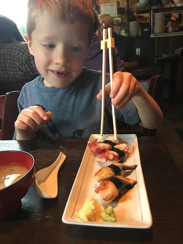 Felix tries octopus sushi