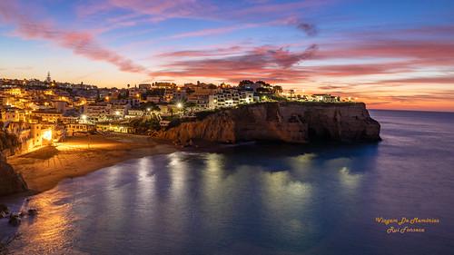 beach carvoeiro sunrise ocean water lights algarve portugal postcard