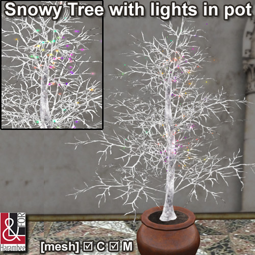 Snowy Tree with lights in pot