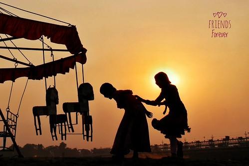 sunset silhouette children merrygoround joy villagelife riverbed damodar bengal india